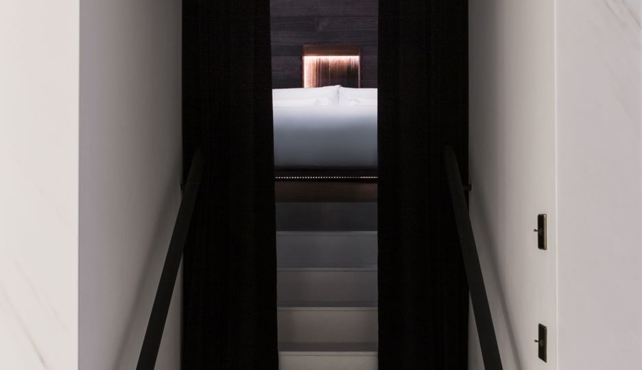 ROOM by Antony Gormley. Stairs to the bedroom inside the sculpture.