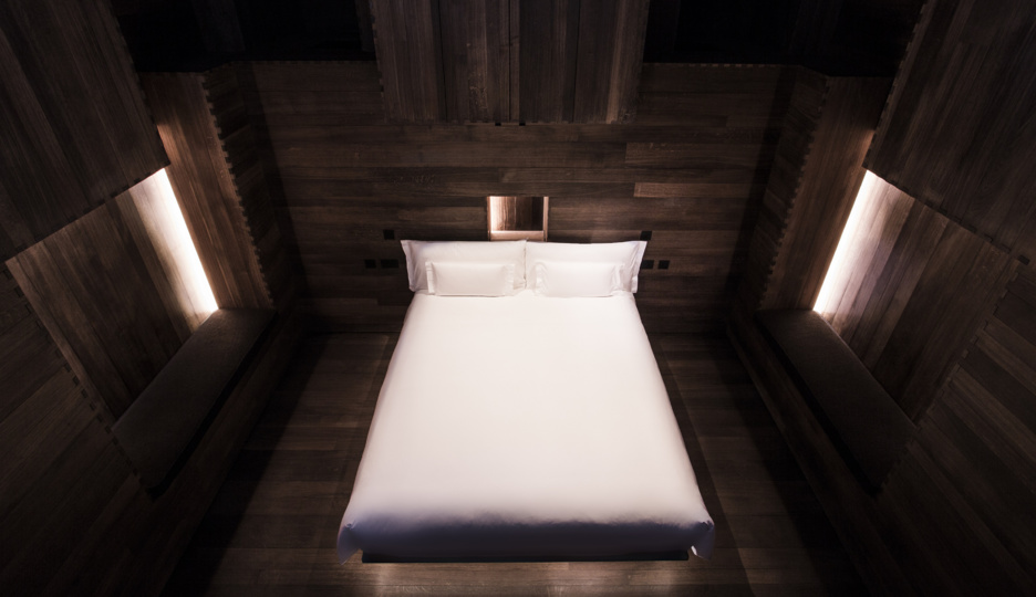 ROOM by Sir Antony Gormley. Wood-panelled bedroom inside the sculpture.