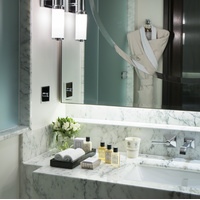 Sleek marble bathroom at The Beaumont Hotel, Mayfair, London